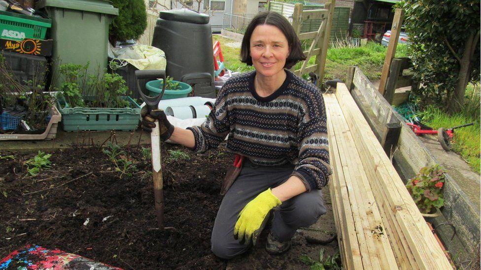 Tamasin Pemberton with spade and soil