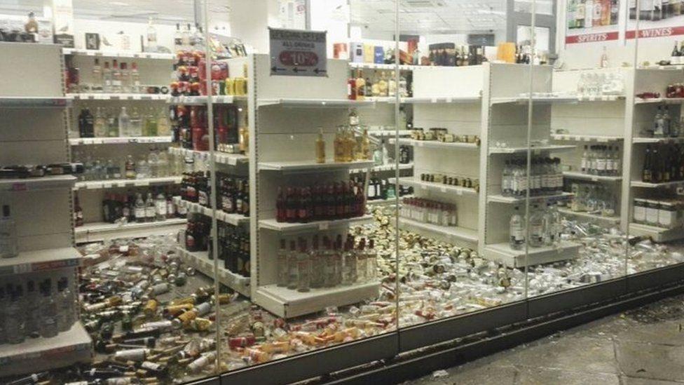 Fallen bottles are seen in a liquor store following an earthquake on the island of Kos,