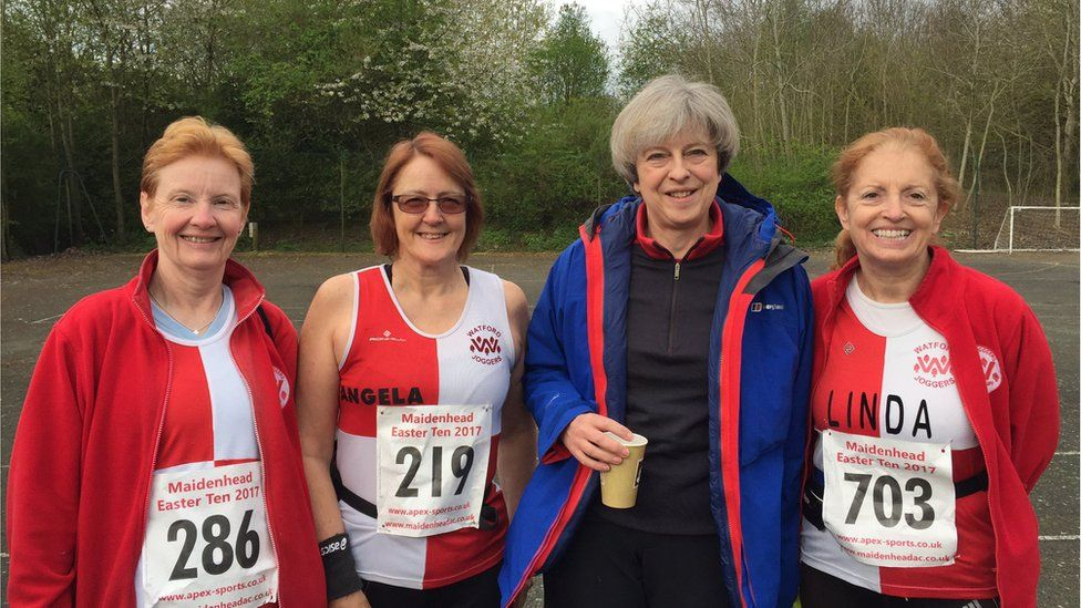 Prime Minister Theresa May with some of the runners from the Watford Joggers group at the annual Good Friday Maidenhead 10-mile race where she was a marshal