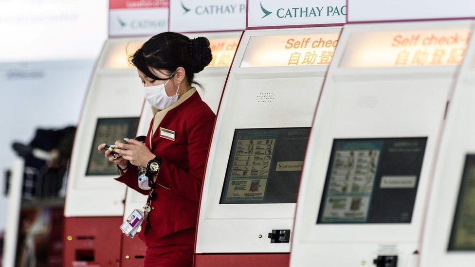 Cathay Pacific cabin crew with mask