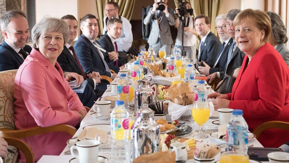 Theresa May at a breakfast meeting with Angela Merkel at the EU-League of Arab States Summit in Sharm El-Sheikh