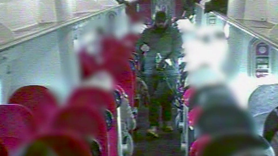 Unescorted and carrying weapons: Khan on the train to London