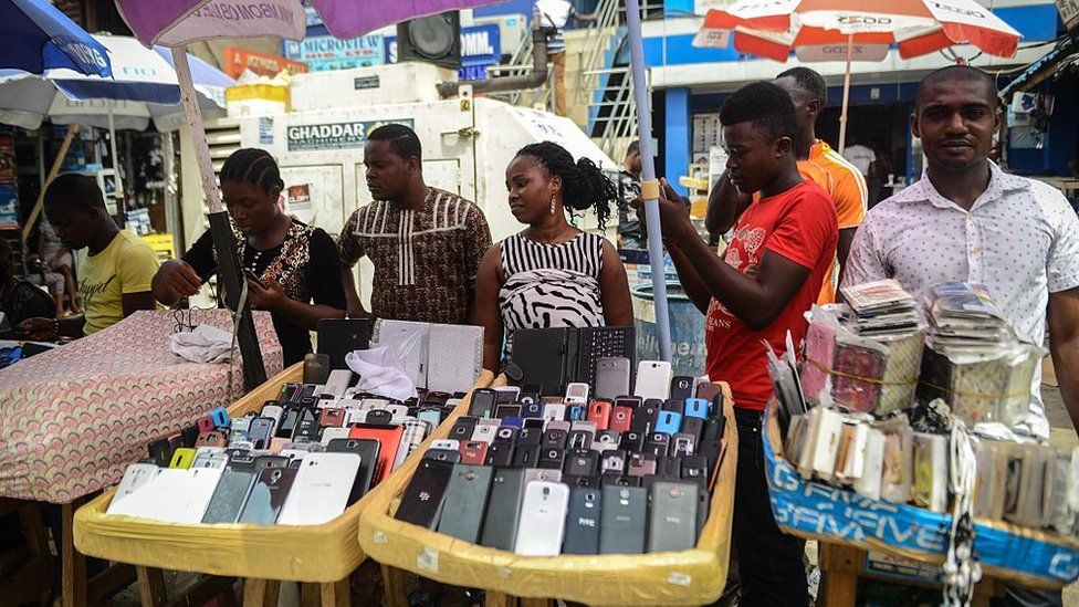 Nigerians are seen at the 'Computer Village', the bazaar where electronic products such as mobile phones, computer hardware and accessories are sold, in the Ikeja suburb of Lagos, Nigeria on February 24, 2015
