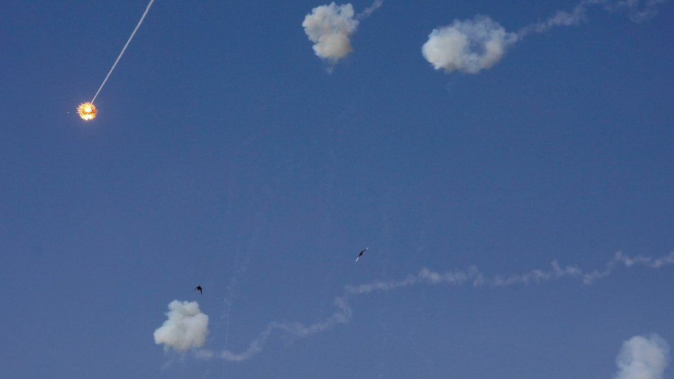 A rocket fired by Palestinian militants is intercepted by Israel's Iron Dome defence system above the Israeli city of Sderot on 13 November 2019