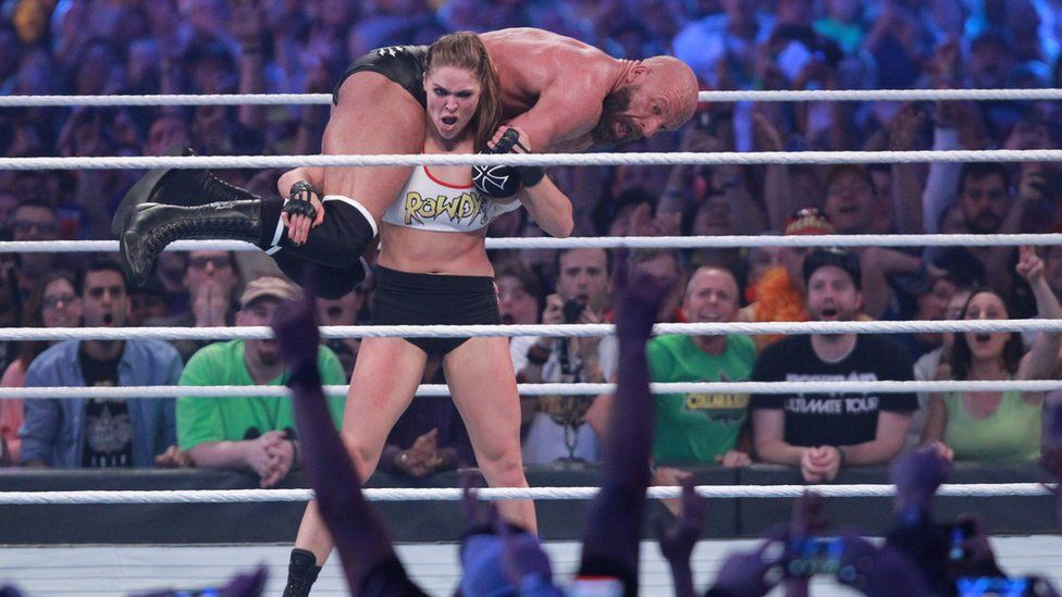 British WWE star Paige retires after neck injury - BBC News