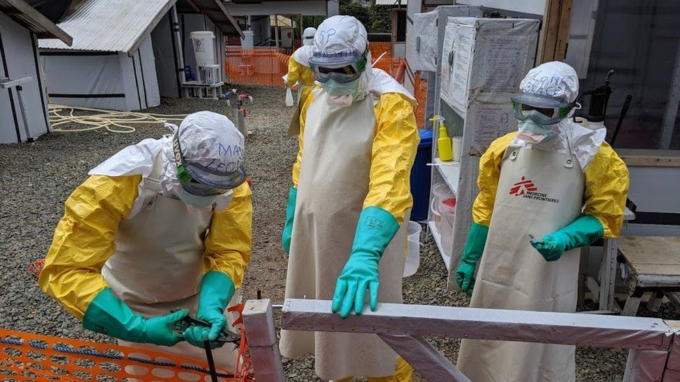 Health workers at an Ebola treatment facility in Sierra Leone