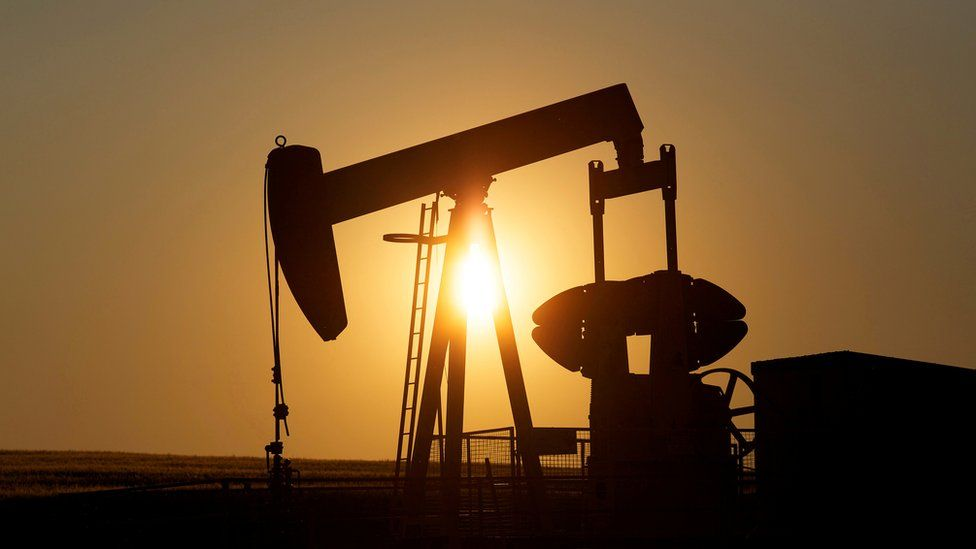 An oil pump jack pumps oil in a field near Calgary, Alberta