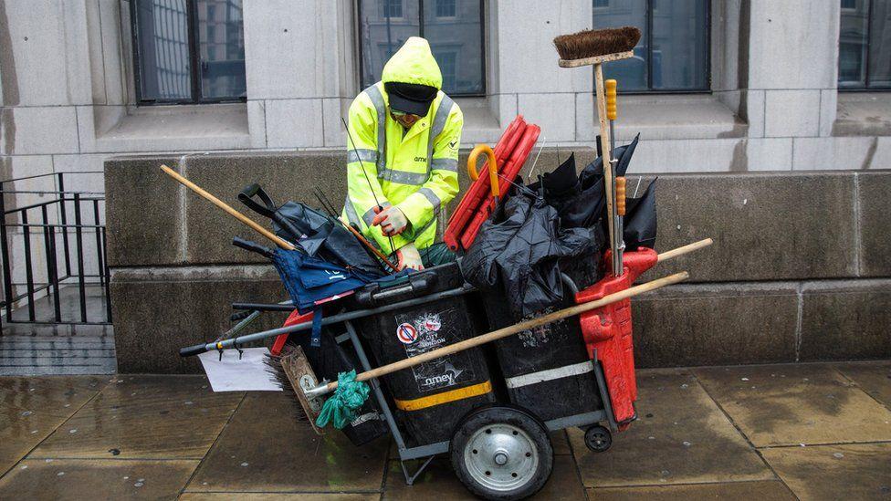 A street cleaner at London Bridge
