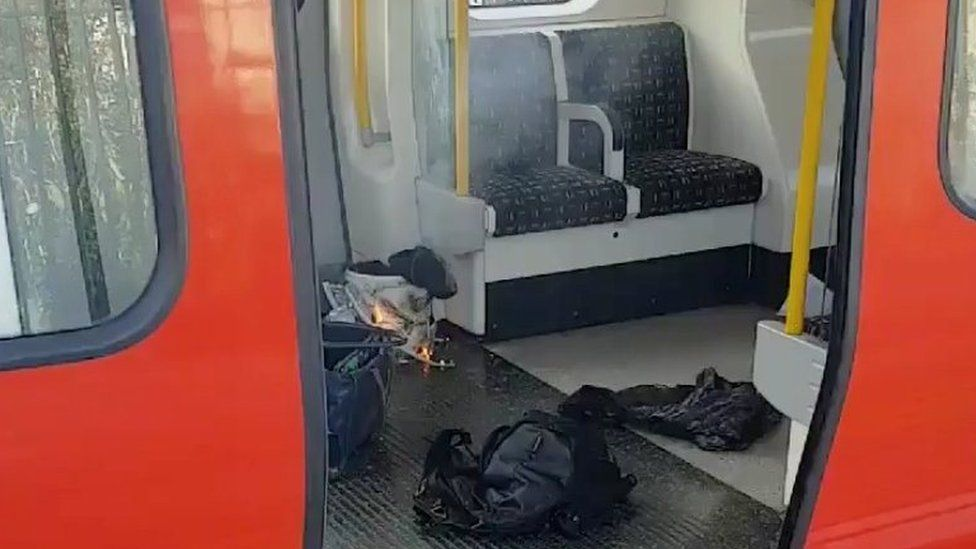 Pictures show a white bucket on fire inside a supermarket bag, with wires trailing on to the carriage floor