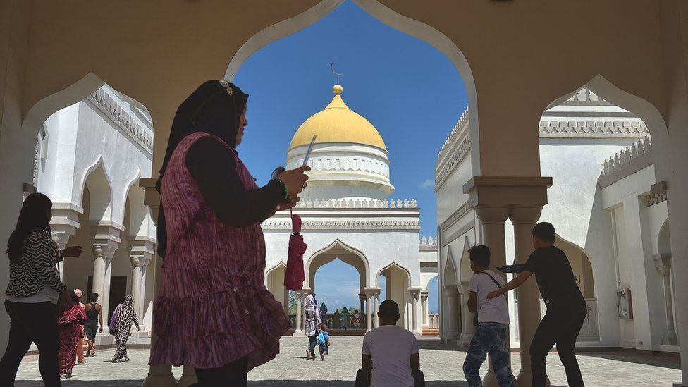 People walk through the hallways of the Golden Mosque in Cotabato City in Maguindanao Province, Philippines