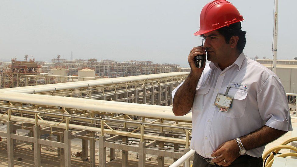 A worker speaks on his walkie-talkie at the South Pars gas field in the southern Iranian port of Asaluyeh