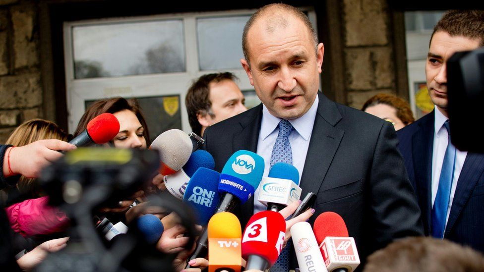 Former head of the Bulgarian airforce Rumen Radev, candidate of the opposition Socialists speaks to the media after casting his vote during the Presidential elections in Sofia