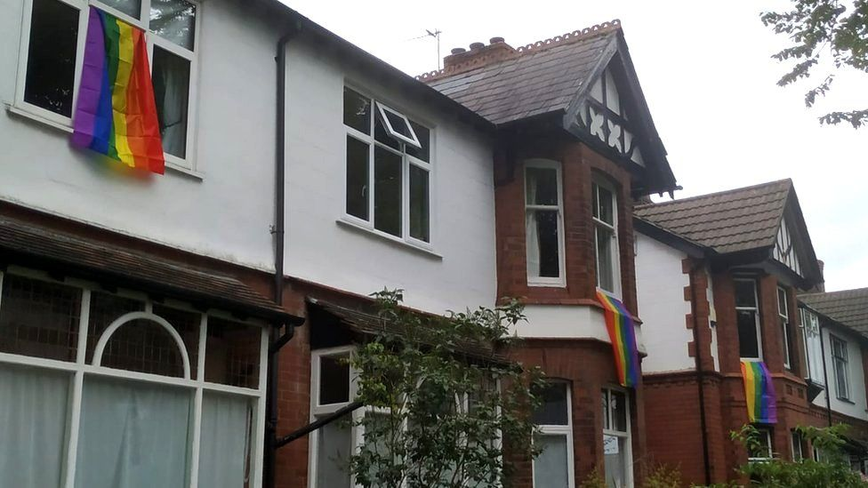 Rainbow flags hung out of windows