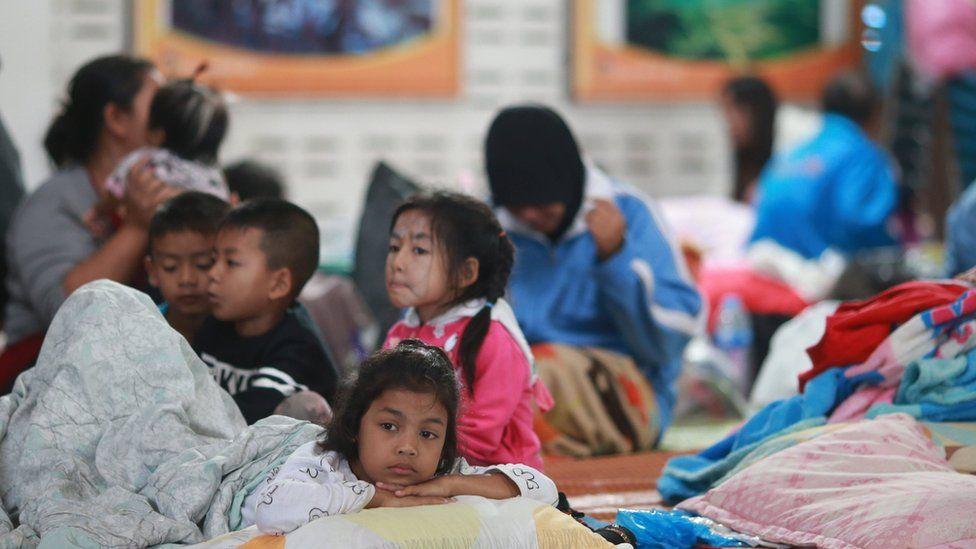 Children lie down at an evacuation centre