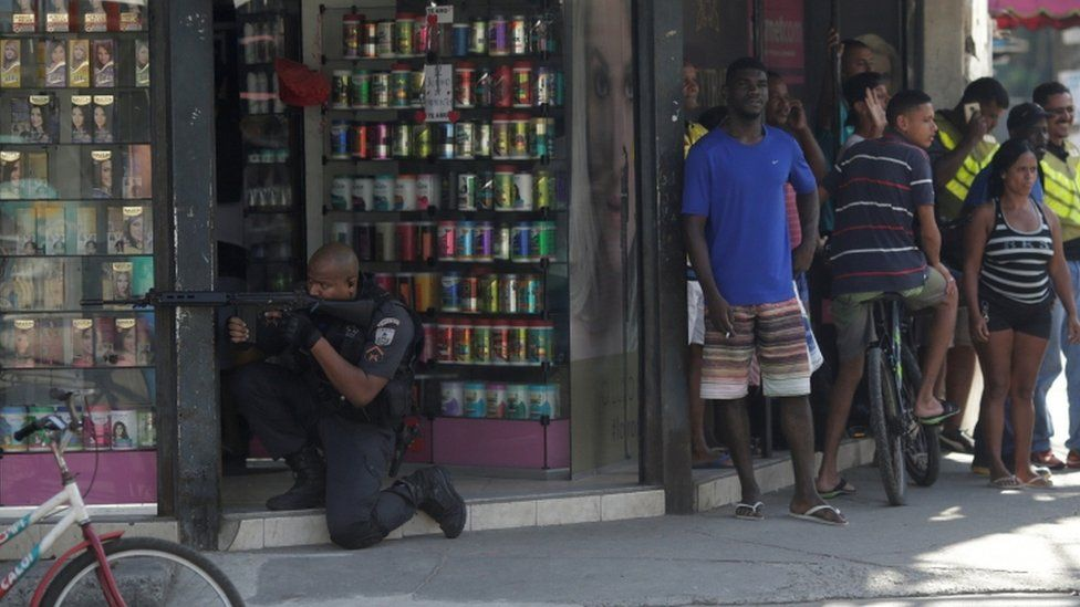 A policeman takes up position during an operation against drug dealers in Cidade de Deus slum in Rio de Janeiro, Brazil, July 10, 2017