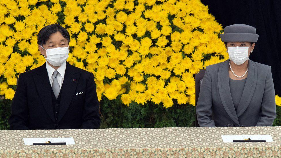 Japan's Emperor Naruhito (L)