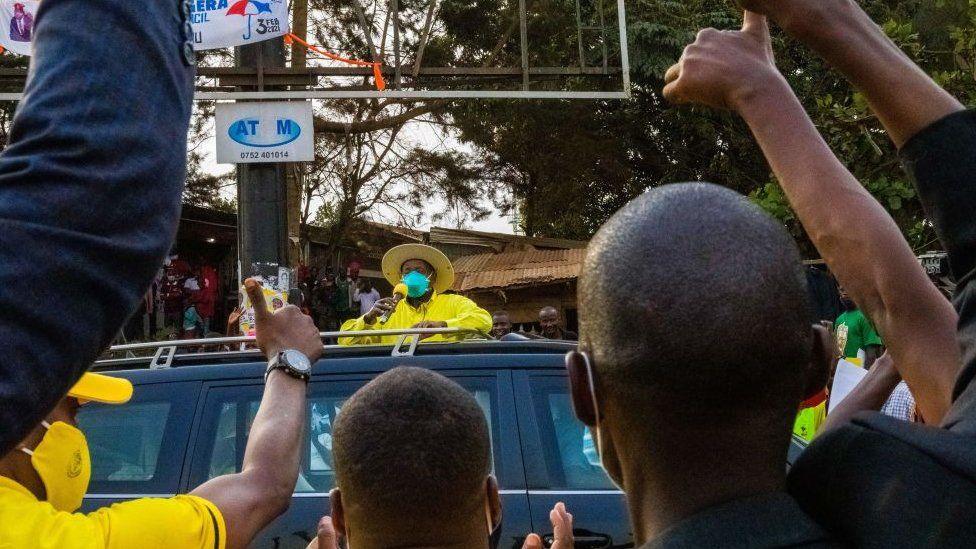 Yoweri Museveni greets his supporters