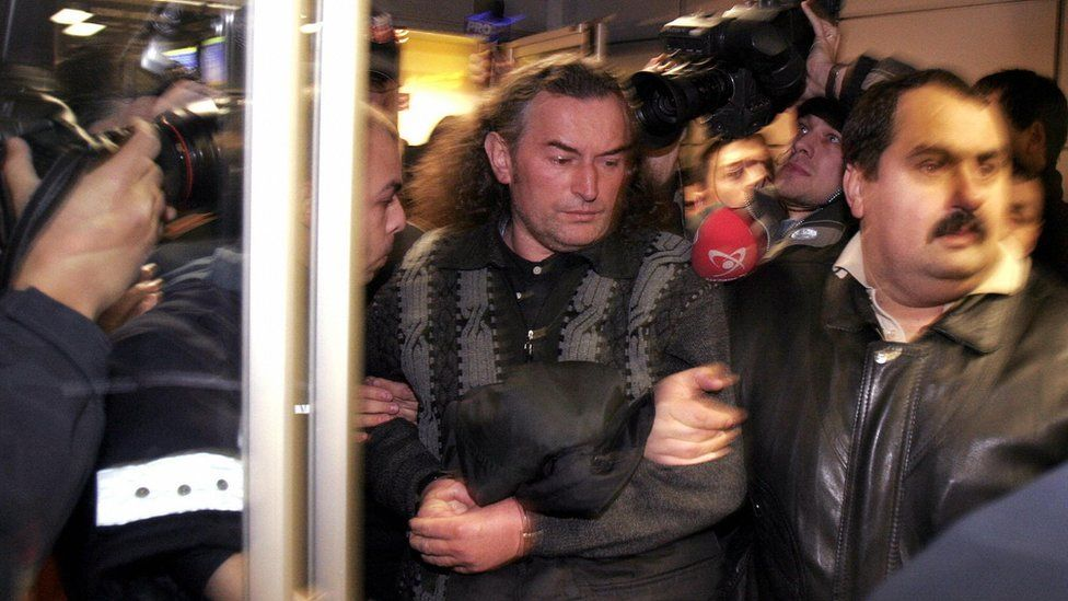 Miron Cozma being arrested in 2004 for his role in bringing down the government in 1991
