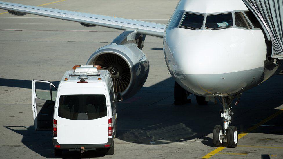 Ambulance beside aircraft