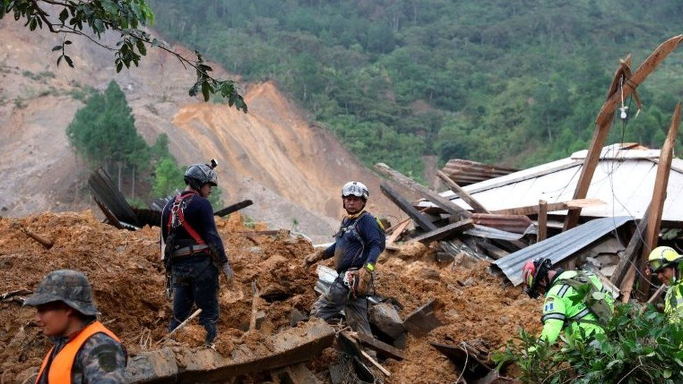 Rescue workers at the scene of a landslide in Guatemala