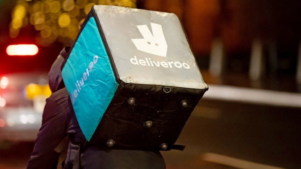 A Deliveroo rider at work at night on December 22, 2018 in Cardiff,