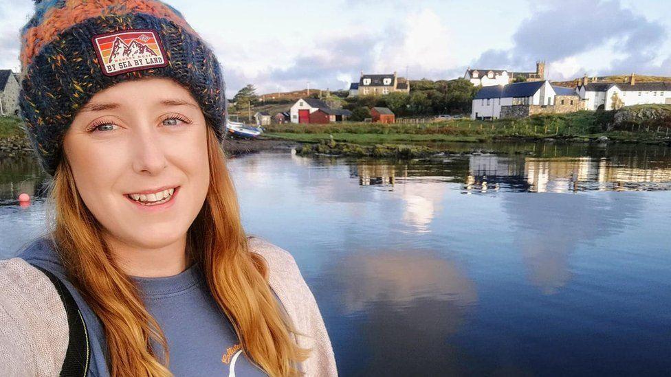 Kay beside a loch