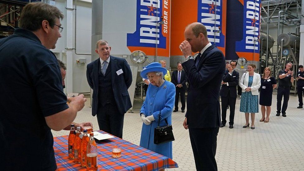 Prince William sips Irn Bru in front of the AG Barr factory, next to the Queen