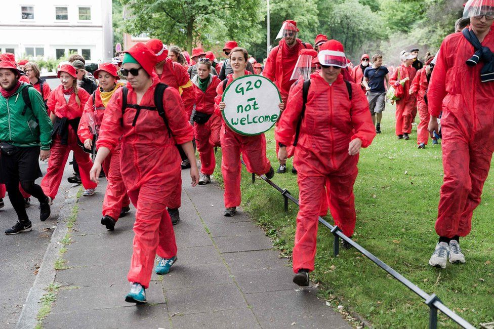 "Demonstrators take part in a protest entitled ""Colour the Red Zone"" in Hamburg, 7 July"