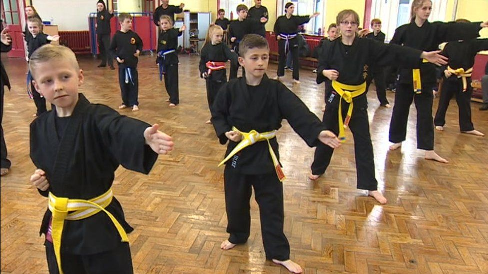 The 'karate kid' helping young carers in north Wales - BBC News