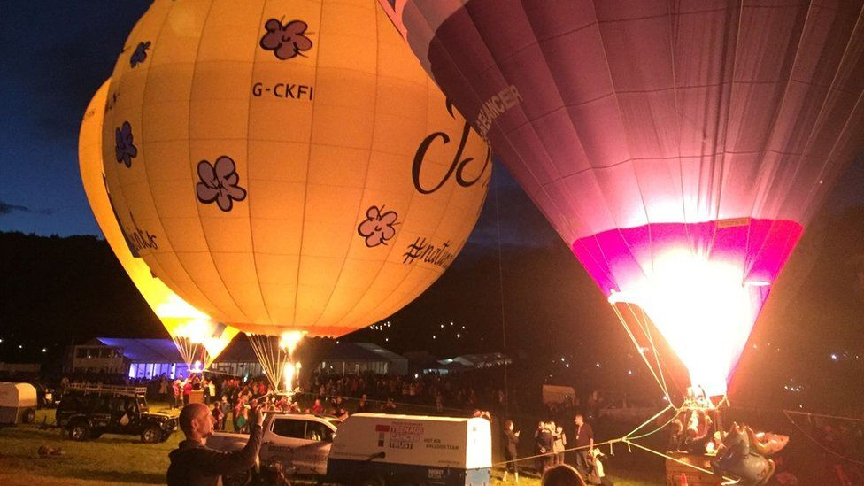 Three balloons lit up