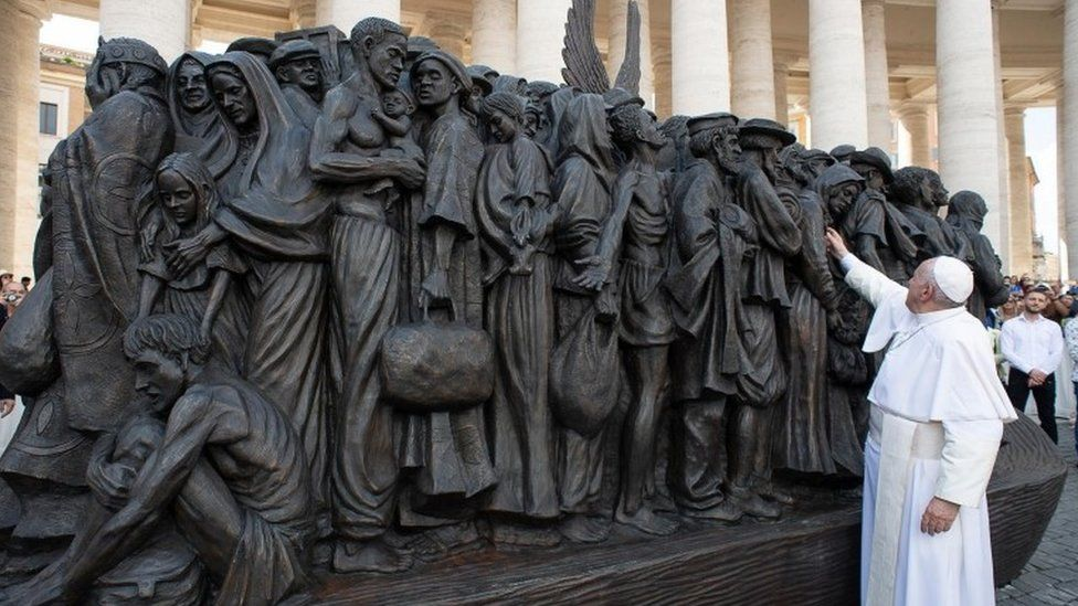Pope Francis inspects the sculpture in St. Peter's Square