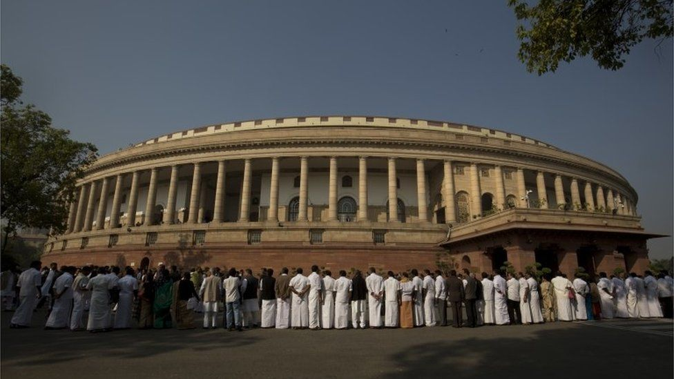 Indian lawmakers from opposition parties form a human chain outside the parliament building during a protest against the government demonetizing high-value bills in New Delhi, India, Wednesday, Nov. 23, 2016.