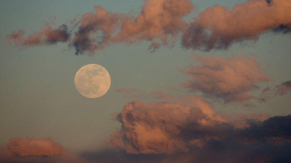 A full moon rises over Rosarito Reservoir on January 20, 2019 near Oropesa, in Toledo province, Spain.