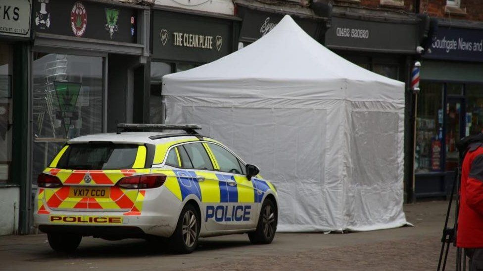 Police car and a white tent outside The Clean Plate