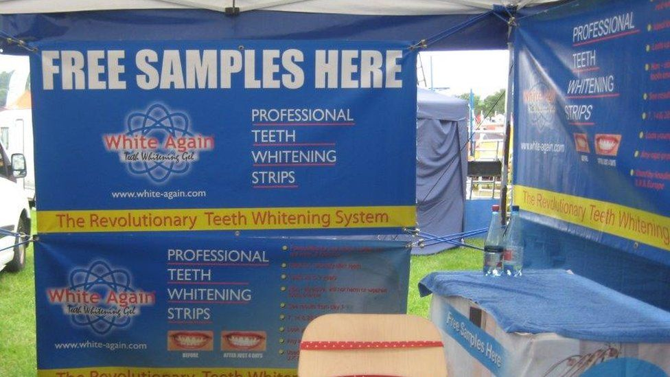 A banner at the teeth whitening stand