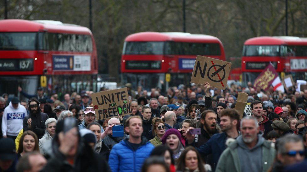 A crowd of protesters demonstrate against lockdown restrictions in London