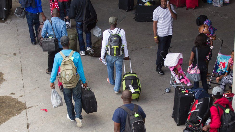 New refugee claimants arrive at Olympic Stadium in Montreal, Quebec.