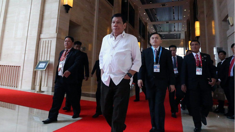 A handout picture released by the Presidential Photographers Division (PPD) shows Philippines President Rodrigo Duterte (centre, hands in pockets) walking to attend a meeting during the Association of Southeast Asian Nations (ASEAN) Summits at the National Convention Centre (NCC) in Vientiane, Laos, 6 September 2016.