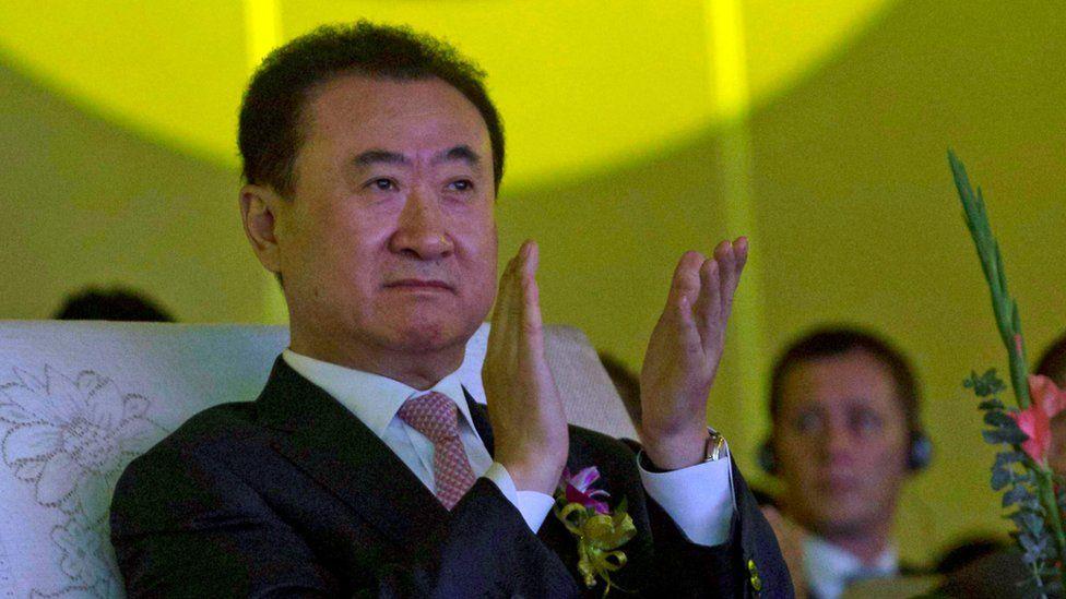 In this June 19, 2013, file photo, Wanda Chairman Wang Jianlin applauds during an event at a hotel in Beijing, China.