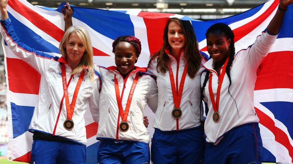 The Great Britain Women's 4x400m relay team celebrate receiving their reallocated bronze medals, from the 2008 Beijing Olympic Games during Day One of the Muller Anniversary Games at London Stadium on July 21, 2018 in London