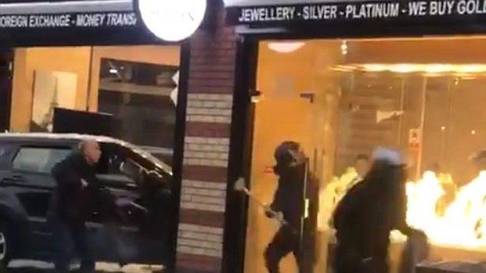 Armed men outside jewellery store