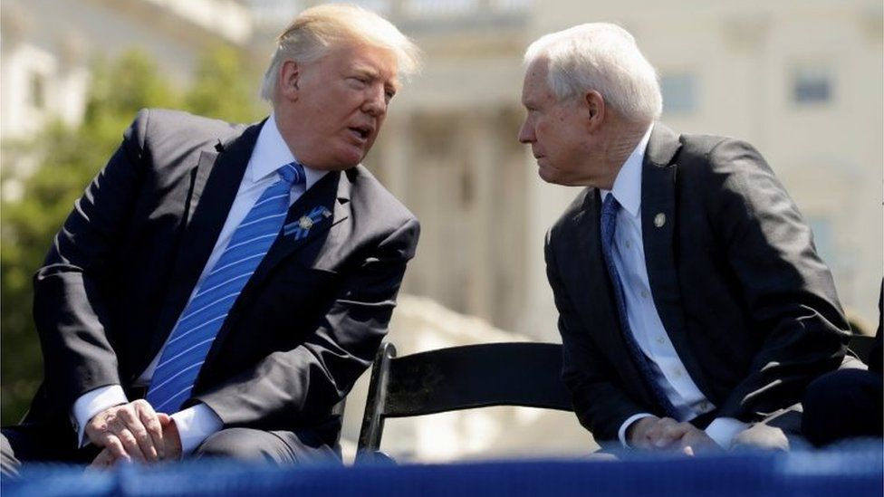 President Donald Trump speaks with Attorney General Jeff Sessions as they attend the National Peace Officers Memorial Service in May in Washington, DC.