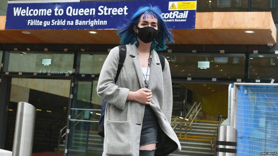 Customer with a mask at Queen Street train station