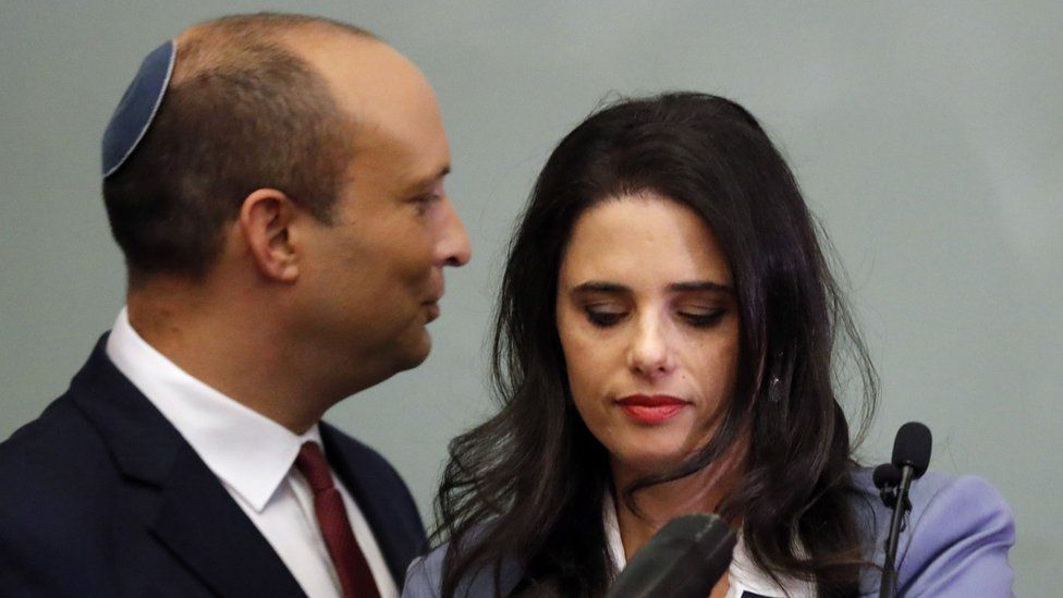 Israeli Education Minister Naftali Bennett (L) and Justice Minister Ayelet Shaked (R) are seen together as they give a statement at the Knesset in Jerusalem on 19 November 2018.