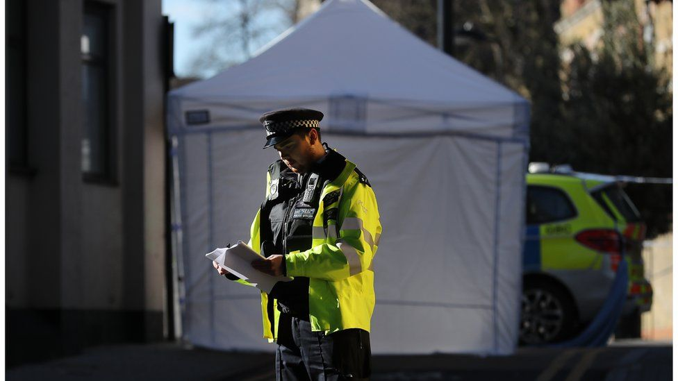 Picture of policeman on Link Street, Camden, where a 20-year-old man was stabbed in April