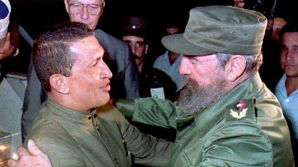 This file picture shows retired Venezuelan military officer Hugo Chavez (L) meeting with Cuban President Fidel Castro (R) upon his arrival at Jose Marti Airport in Havana 13 December, 1994.