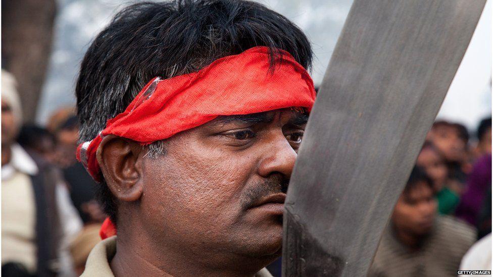A man prepares for sacrifices at the temple (28 November 2014)