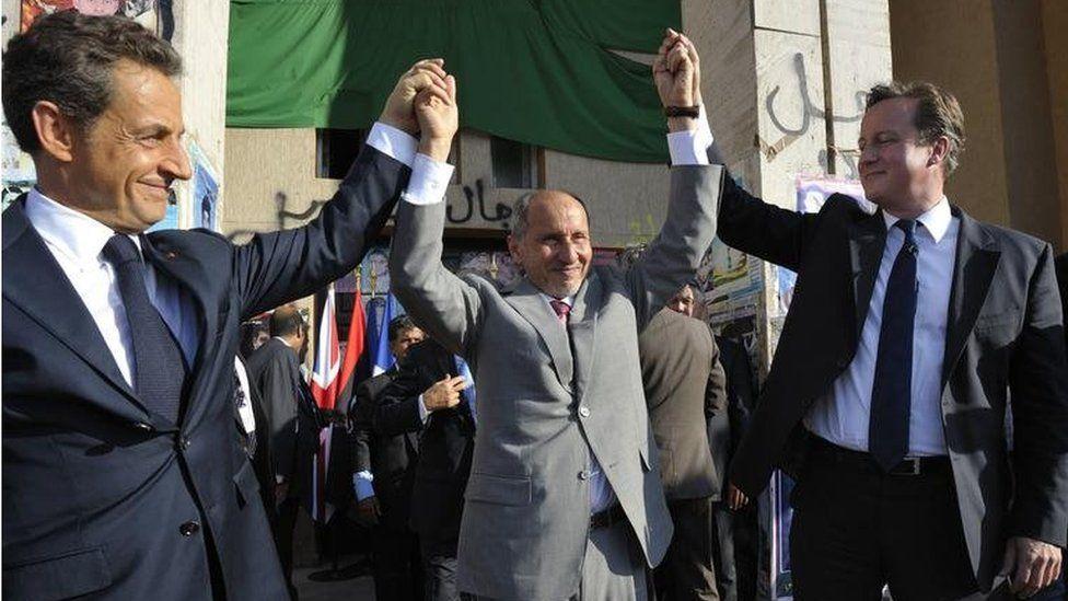 Nicolas Sarkozy, National Transitional Council head Mustafa Abdul Jalil and David Cameron