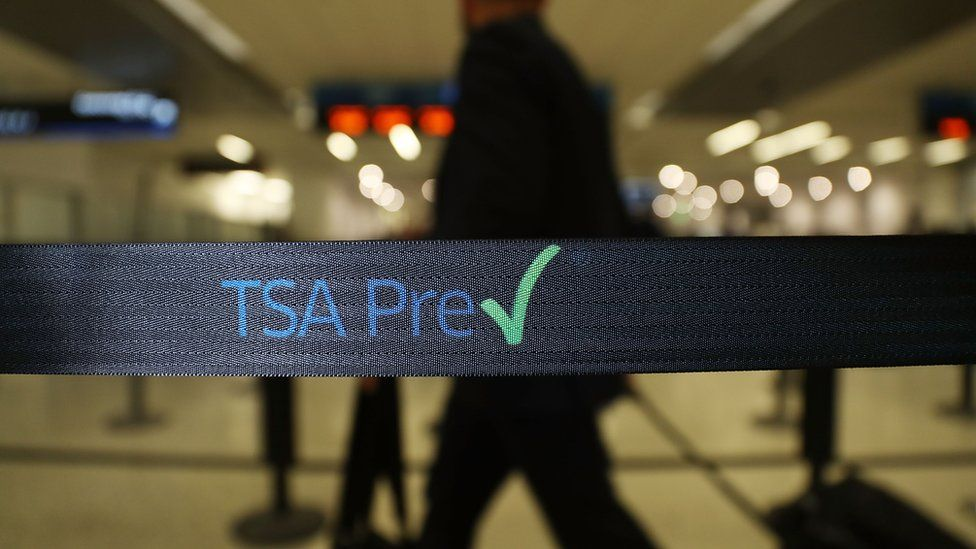 Travellers go through the TSA PreCheck security point at Miami International Airport on June 2, 2016 in Miami, Florida.