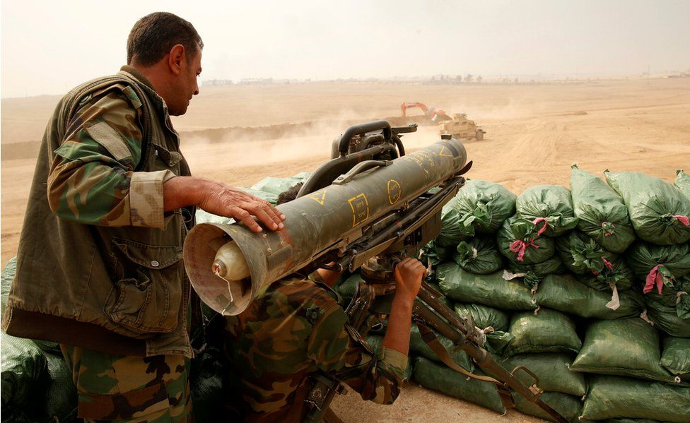 A Kurdish Peshmerga fighter pictured with a Milan anti tank weapon guards against possible Islamic State suicide bomb attacks during a battle with Islamic State militants at Topzawa village, near Bashiqa, near Mosul, Iraq.
